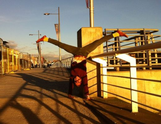 Handstand by the Clyde in Glasgow on a sunny day