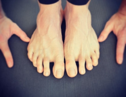 Yoga hands and feet, forward fold, padangusthasana