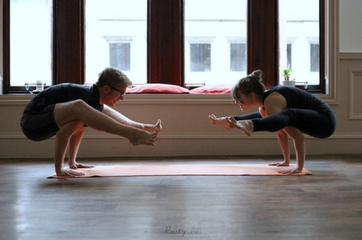 YOGALEN and Laura doing titibasana or firefly pose